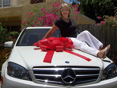 Jane loves her Mercedes-Benz. Thank you, Arbonne! }}