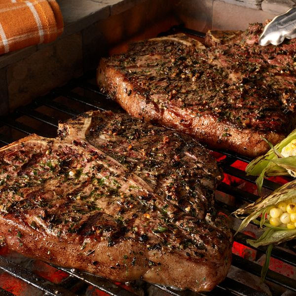 grilled-porterhouse-steaks-with-garlic-herb-peppercorn-crust-with-corn-horizontal