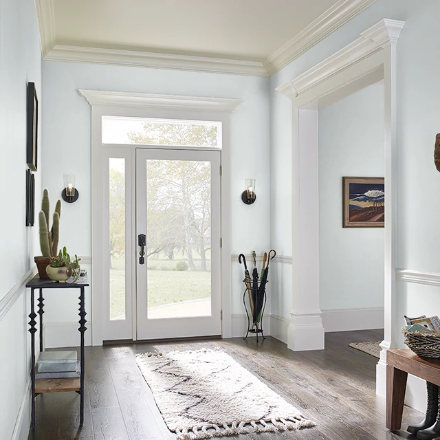 Foyer painted in HINT OF BLUE