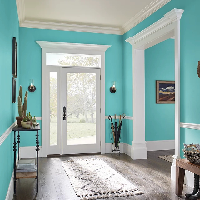Foyer painted in VIVID TURQUOISE