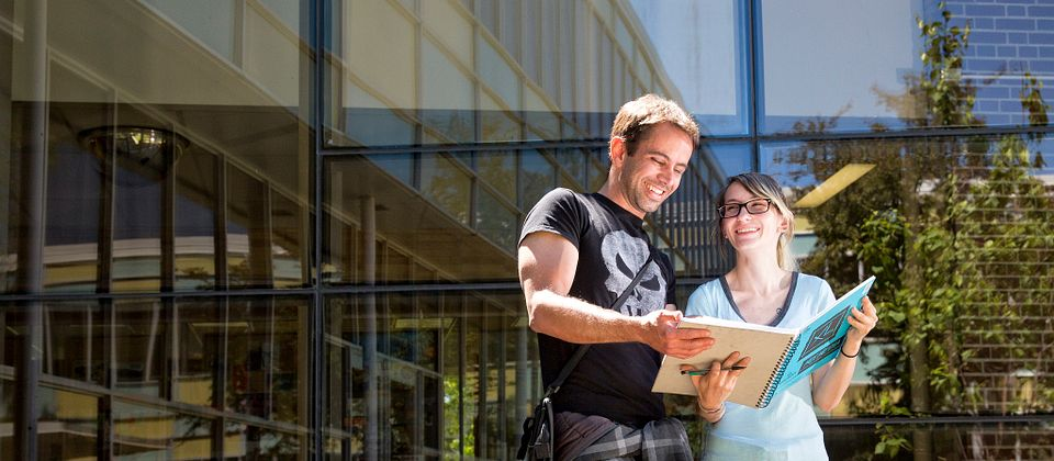 Image of two Centennial College Students at the courtyard