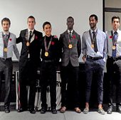 picture of the centennial college colts men's cross country team and their bronze medals