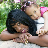 picture of Led young College Human Resources Management program graduate Starleeta Brown with her daughter