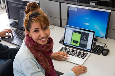 picture of a Centennial College Mobile Applications Development program student in a lab developing a mobile phone app