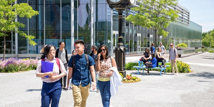 picture of Centennial College students walking together through the Progress Campus courtyard