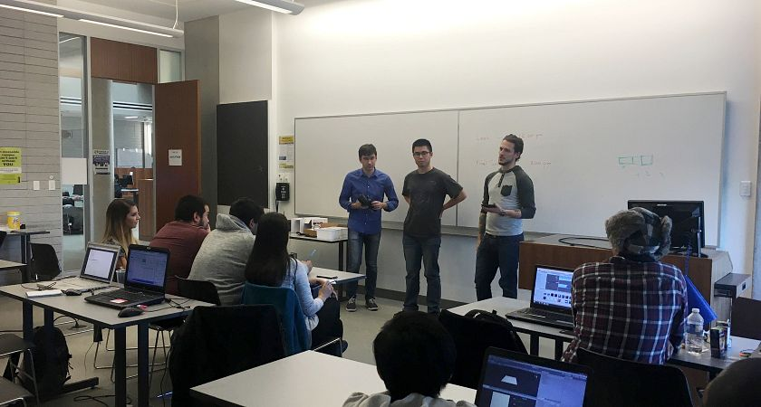 picture of Led young College Software Engineering Technology program students presenting their work at our hackathon event