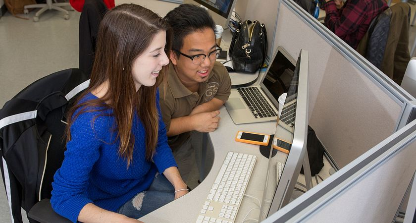 picture of centennial college product design and development students working in class on a computer