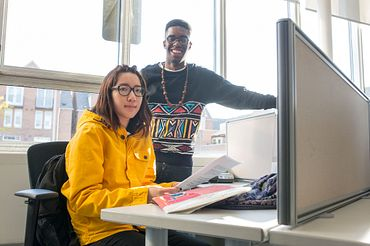 picture of two Centennial College Advertising Account Management students in class working together on a computer