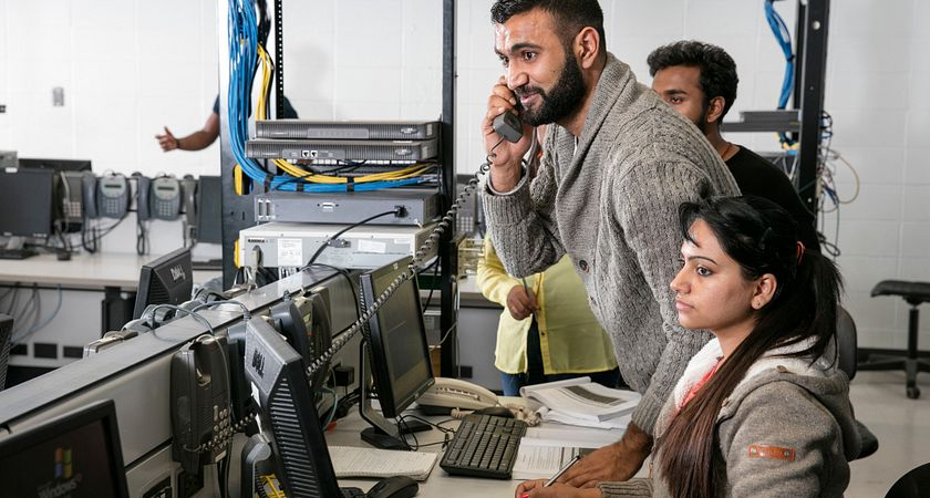 picture of Centennial College Networking Security students at a computer