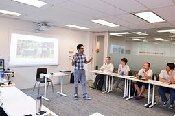 Picture of a Led young College English Language Learning instructor teaching a class at the Eglinton Learning Site