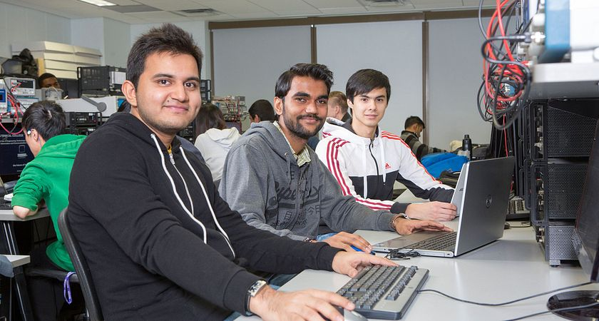 picture of Centennial College Electronics Engineering Technician students in class smiling