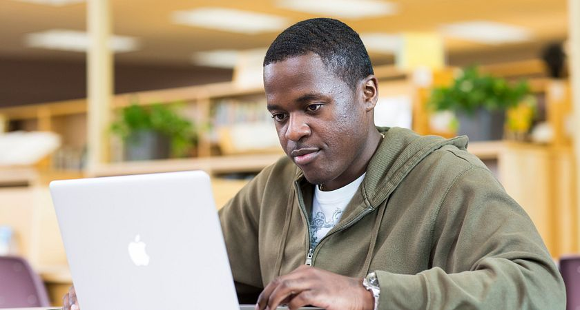 picture of a centennial college distance learning student on a laptop