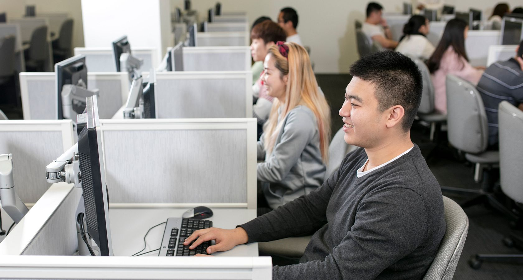 picture of a group of people taking the computer-delivered IELTS test