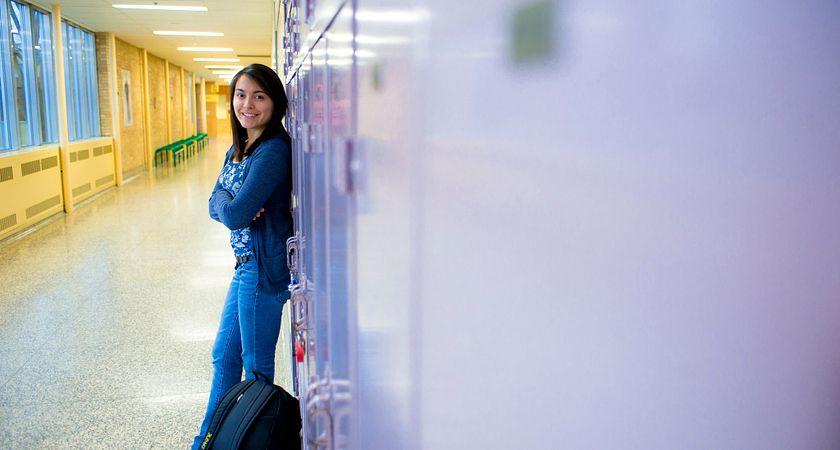 Aboriginal student leaning against a locker