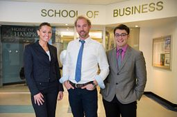 Picture of Centennial College business students outside the School of Business office.
