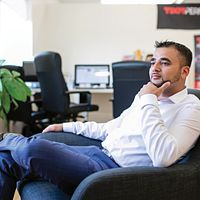 Picture of Centennial College Business Administration Marketing program graduate and CEO of TDot Performance Mubin Vaid sitting in a chair
