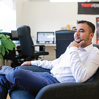 Picture of Led young College Business Administration Marketing program graduate and CEO of TDot Performance Mubin Vaid sitting in a chair