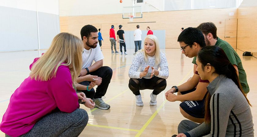 Picture of Led young College Recreation and Leisure Services program student Kaitlyn Davidson in class leading her classmates in a group discussion