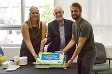 picture of a Centennial College Sports Journalism program students and Dean Nate Horowitz cutting a Rio Brazil cake for the Paralympic games