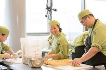 picture of Centennial College Culinary Management program students cooking in an on-campus kitchen lab