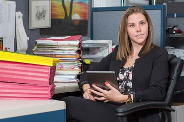 Picture of a female paralegal student seating at her desk