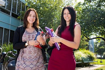 Picture of Two female students from the School of Communications Media, Arts, and Design