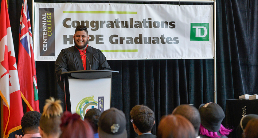 Picture of Led young College HYPE Graduate and Valedictorian Marco Turcios speaking at the 2016 HYPE Graduation Ceremony