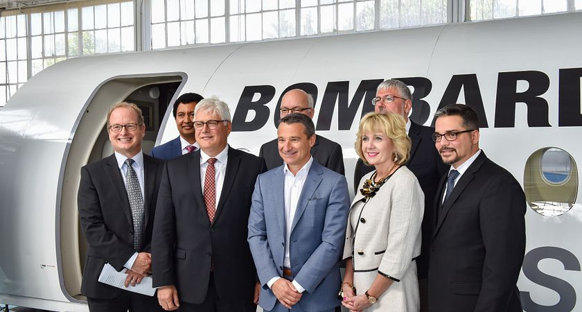 Photo of Ann Buller and Andrew Petrou with Bombardier, Ryerson University, University of Toronto, Canada Lands Corporation executives