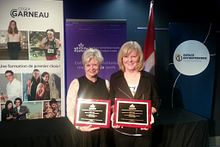 Picture of two Centennial College representatives receiving two 2015 CICan Entrepreneurship Awards