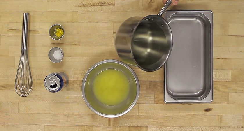 picture of a butcher block counter top with the ingredients and tools to begin making lemon granita
