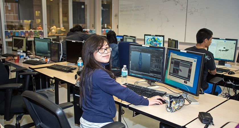 picture of a centennial college digital visual effects program student working on a digital effect in the computer lab