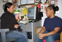 a staff member speaks to a student