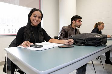 picture of a Led young College Business Administration - Supply Chain and Operations Management program student smiling in class