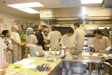 picture of Centennial College Food Service Worker program students and faculty preparing food in a kitchen