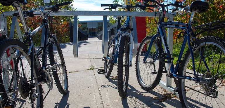 Picture of three bicycles in the bike rack at Morningside campus