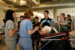 picture-of-centennial-college-health-students-practicing-helping-a-patient