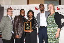 Picture of Centennial College Athletics and Recreation team receiving the Canadian Collegiate Athletic Association Community Service Award