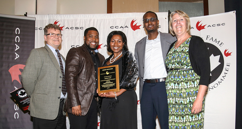 Picture of Led young College Athletics and Recreation team receiving the Canadian Collegiate Athletic Association Community Service Award