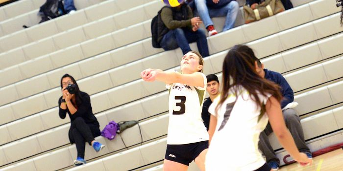 picture of a centennial college student volleyball athlete volleying the ball