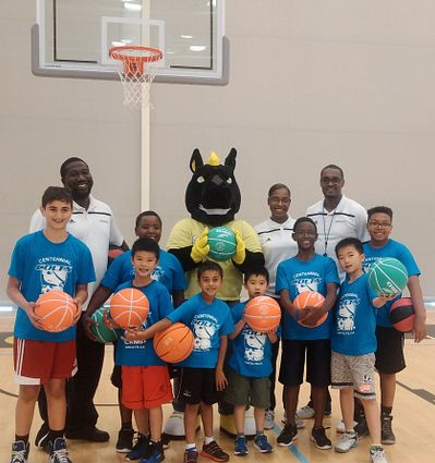 Picture of children from the Centennial Colts summer camps with staff and mascot