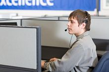 Photo of Call Centre Worker at Computer