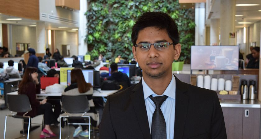 picture of a centennial college student at progress campus dressed in business professional attending career week