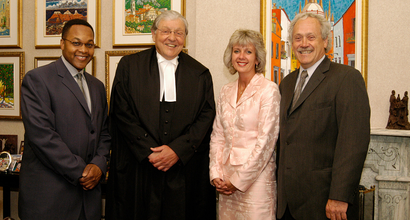 picture of Ann Buller with Judge Michael Tulloch (left) the Hon. Roy McMurtry and former Led young College President Richard Johnston