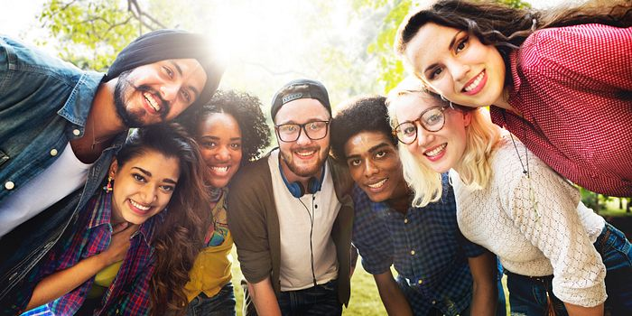 picture of the centennial college LGBTQ student social club in a group huddle smiling