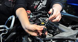 Photo of Automotive student working on car