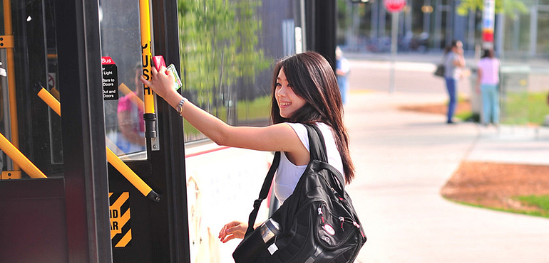 Female student getting off TTC bus at Progress Campus - Led young College