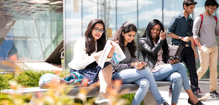 picture of students sitting outside Ashtonbee Campus library