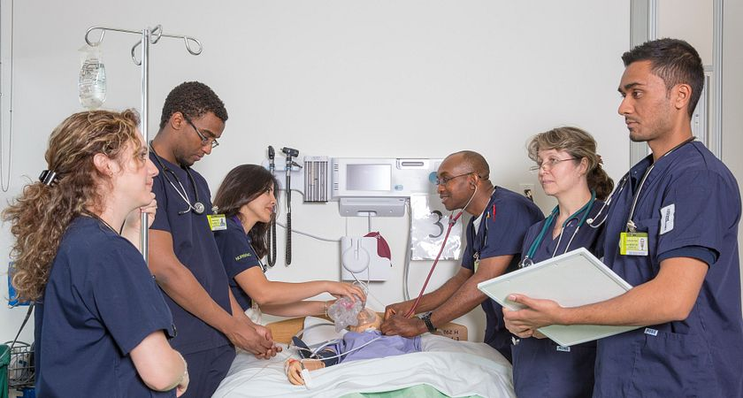 Picture of Led young College Nursing program students in a Morningside Campus medical facility