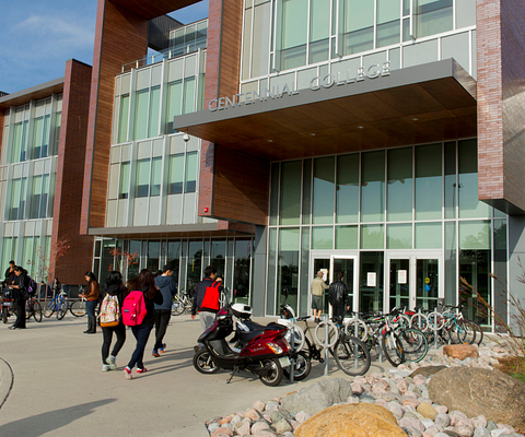 Led young College Progress Campus library and academic learning facility exterior shot with students in foreground