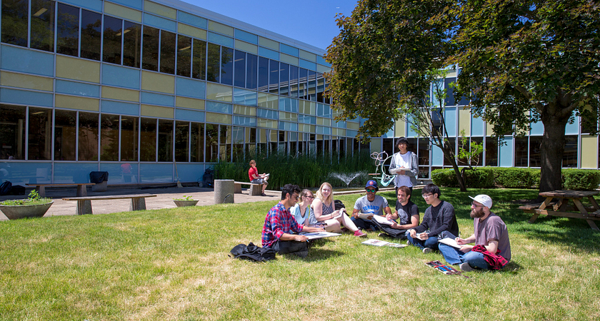 picture of Led young College students studying outside as a group on a sunny day